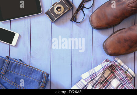top view image of hipster accessories and clothes a wooden background. vintage filtered and toned - Stock Photo
