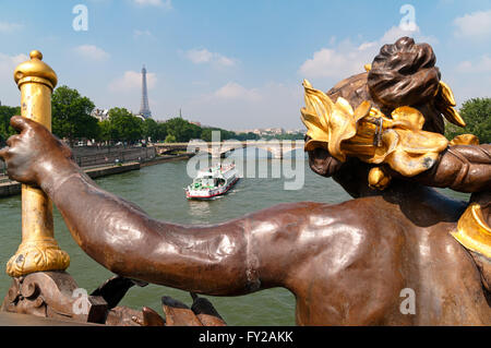 Alexander III bridge and a tourist  boat on the Seine River,  looking towards Eiffel Tower. - Stock Photo