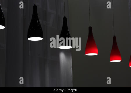 Black and red glass modern pendant lamps. - Stock Photo