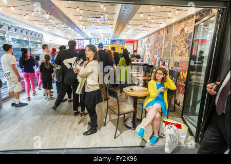 Visitors to Yong Kang Street in the Columbus Circle station in the subway in New York in the new Turnstyle food - Stock Photo