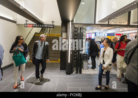Visitors to the Columbus Circle station in the subway in New York try out the new Turnstyle food hall and retail - Stock Photo