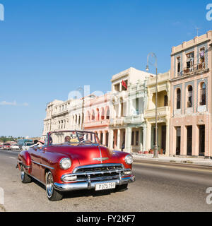 Square streetview of classic American cars driving down the Malecon in Havana, Cuba. - Stock Photo