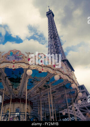 Eiffel Tower and carousel, Paris, France - Stock Photo
