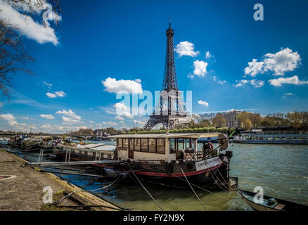 Boats on the river Seine in Paris, France, with Eiffel Tower in background - Stock Photo