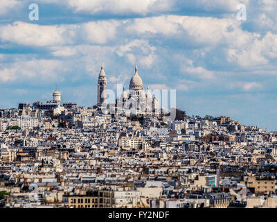 The Basilica of the Sacred Heart of Paris, commonly known as Sacré-Cœur Basilica and often simply Sacré-Cœur - Stock Photo