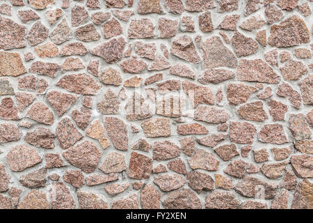 Stone wall (fence). Close-up picture of bricks. - Stock Photo
