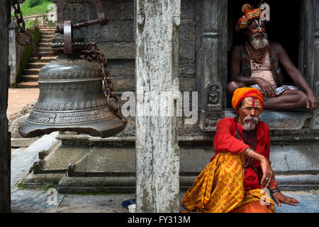 Portrait of a sadhus in Pashupatinath, Nepal. The place of the cremations by the Bagmati River. Holy men sadhu colourfully - Stock Photo