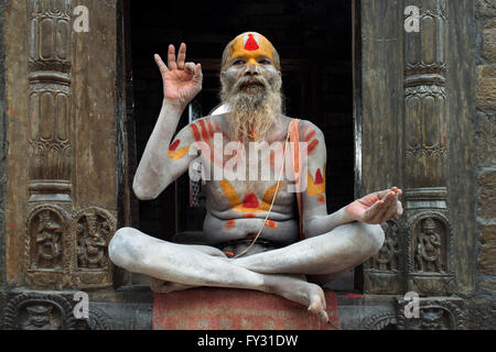Portrait of a sadhu in Pashupatinath, Nepal. The place of the cremations by the Bagmati River. Holy man sadhu colourfully - Stock Photo