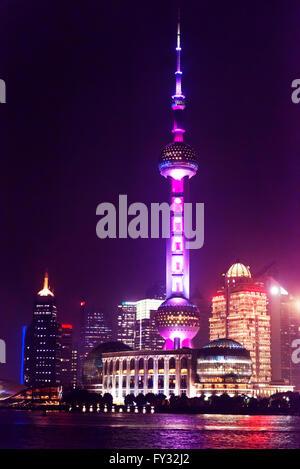The Oriental Pearl Tower illuminated at night, Huangpu River, Lujiazui, Pudong, Shanghai, China - Stock Photo