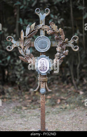 Iron cross on a grave with a sprig of laurel, oak leaves and a portrait medallion, World War I in 1917, Aquileia, - Stock Photo