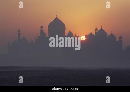 Taj Mahal at sunrise - Stock Photo