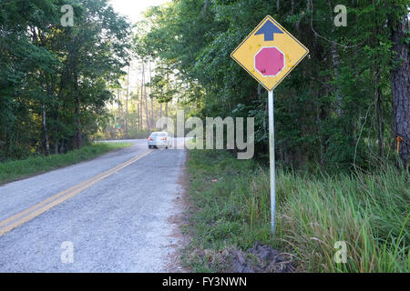 Stop at road junction sign on a small country road in Florida where it joins a major highway. April 2016 - Stock Photo