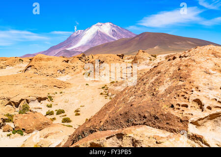 Active volcano with the smoke in Uyuni Bolivia - Stock Photo