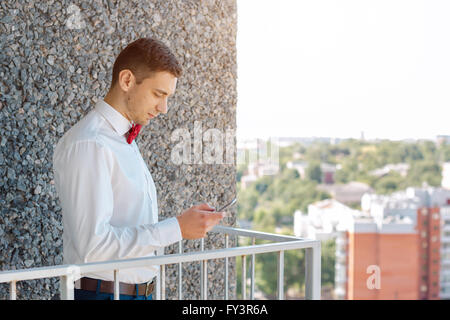 Serious Groom waiting for call - Stock Photo