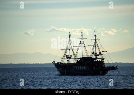 Wooden vintage frigate 'Arabella' ship converted to a bar-caffe, touring in Thermaic gulf water. Thessaloniki, Greece - Stock Photo