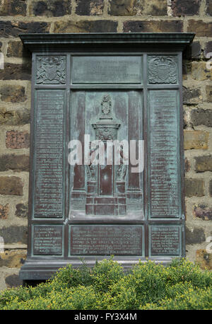 wall mounted bronze plaque that forms the london troops war memorial in vicarage garden, fulham, london, england - Stock Photo
