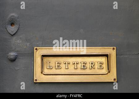 Details of an old Italian letter box on wooden door in Italy - Stock Photo