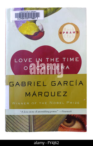The front page of Love In The Time Of Cholera by Gabriel Garcia Marquez photographed against a white background. - Stock Photo