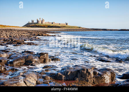 Dunstanburgh Castle on the Northumberland coast, North East England. - Stock Photo