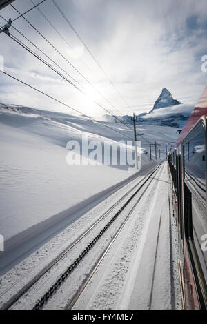 The Matterhorn is visible from a train of the famous Gornergrat railway that leads from the village of Zermatt up - Stock Photo