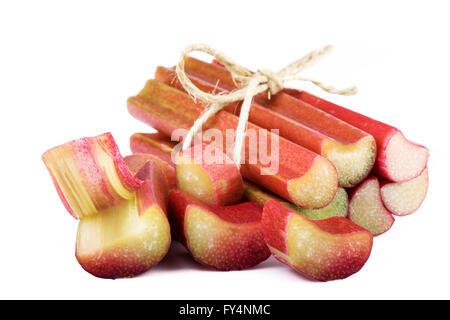 bundle of rhubarb stalks on white background - Stock Photo
