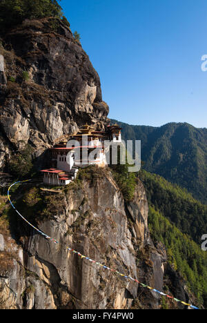 The dramatic Tiger's Nest (Taktshang) Monastery, perched on cliff near Paro, Bhutan - Stock Photo