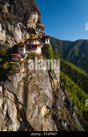 Spectacular Tiger's Nest Monastery (Taktshang Goemba), perched on cliff near Paro, Bhutan - Stock Photo