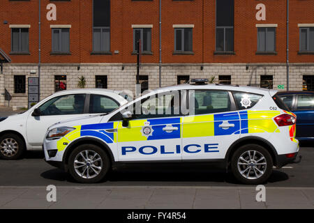 Police car vehicular Traffic on 'The Strand' the main highway across the front of Liverpool City, adjacent to dockland - Stock Photo