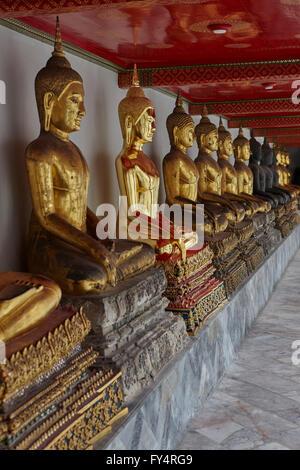 Buddha images in the cloister of Wat Pho, Bangkok, Thailand - Stock Photo