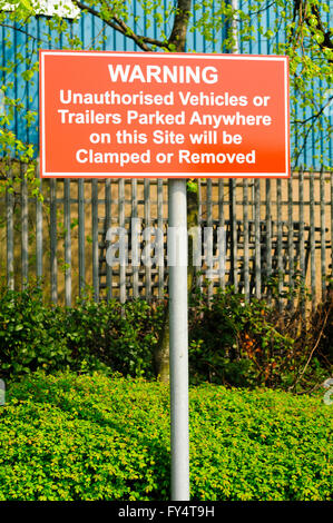No Parking sign, indicating cars will be clamped and towed away - Stock Photo