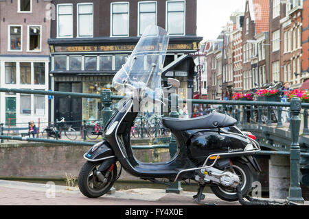 In Amsterdam, scooters are very convenient - perhaps even a better option than a car.  Vespa scooter. - Stock Photo