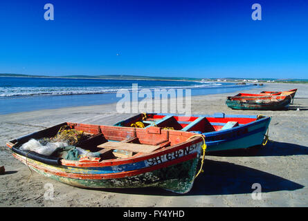 Wooden fishing boats on beach; Cape Town; Cape Peninsula; South Africa - Stock Photo