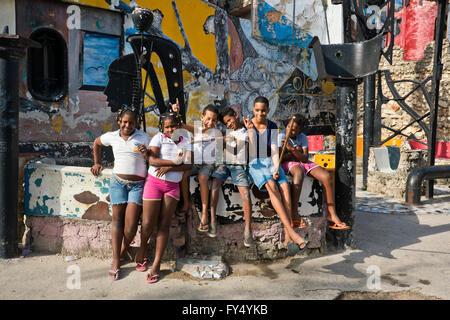 Horizontal portrait of children at Hamel's Alley in Havana, Cuba.