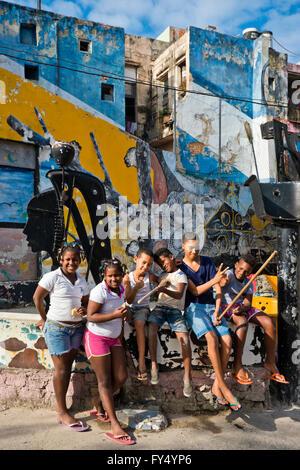 Vertical portrait of children at Hamel's Alley in Havana, Cuba.