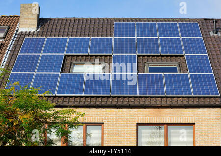 Solar Panels Photovoltaic Modules On A Roof Produced By