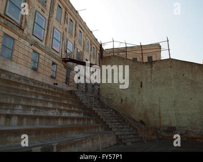 Staircase leading from Prison yard into old Prison building on Alcatraz Island, California. - Stock Photo