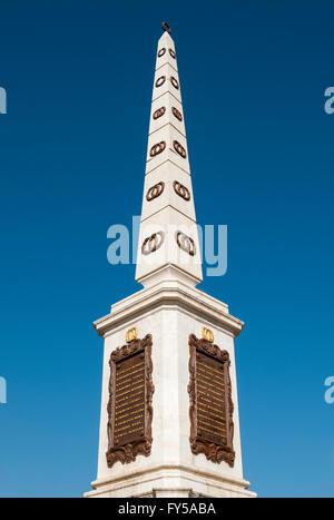 Obelisk in memory of General Torrijos, Plaza de la Merced, Malaga, Andalusia, Spain - Stock Photo
