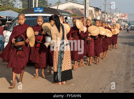 Monks on morning alms round in the streets of Mawlamyine, Mawlamyaing, Mon State, Burma, Myanmar - Stock Photo