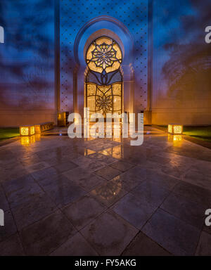 Sheikh Zayed Grand Mosque luxury Gate by night with some beautiful color lights - Stock Photo