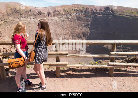 Visitor / visitors tourist / tourists view the crater of Mt. Mount Vesuvio / top summit of Mount Vesuvius near Naples, - Stock Photo