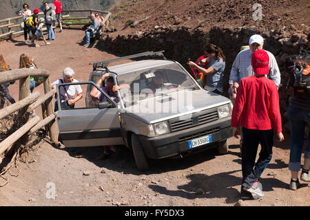 Fiat Panda 4 by four carries non walking tourist / tourists to the top summit of Mount Vesuvius / Mt. Vesuvio near - Stock Photo