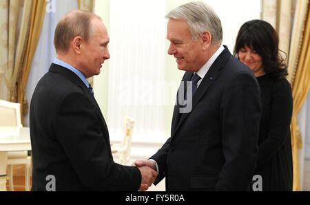 Russian President Vladimir Putin greets French Foreign Minister Jean-Marc Ayrault prior to their meeting at the - Stock Photo