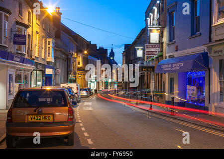 Cardigan High Street in Ceredigion, Wales.  Taken at twilight with traffic trails streaks of light. - Stock Photo