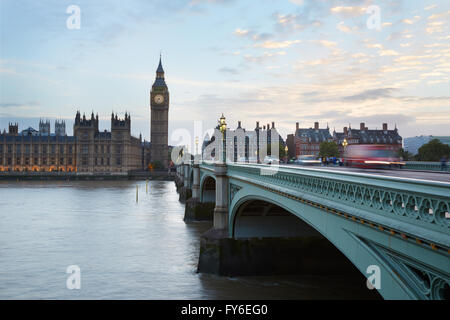 Big Ben and Palace of Westminster, traffic on bridge at dusk in London, natural light and colors - Stock Photo