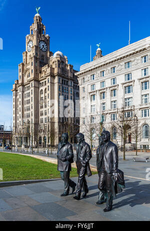 Andrew Edward's sculpture of The Beatles in front of the Royal Liver and Cunard buildings, Pier Head, Liverpool, - Stock Photo