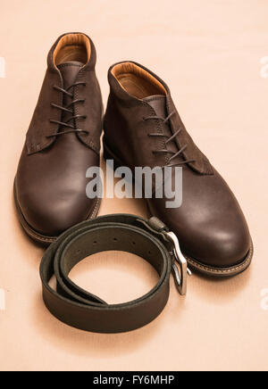 Men's brown leather boots and belt - Stock Photo