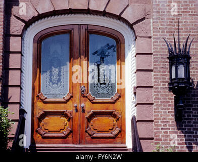 Double wooden door with etched glass windows; historic old house in downtown Charleston; South Carolina; USA - Stock Photo
