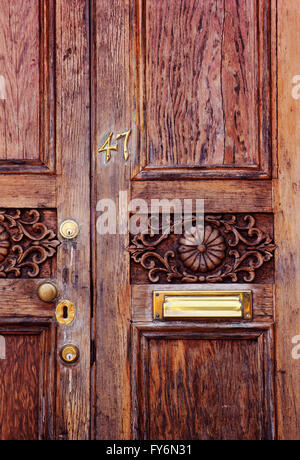 Wooden door & brass hardware of historic old house in downtown Charleston; South Carolina; USA - Stock Photo