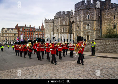 The Band of the Irish Guards lead the 1st Battalion of the Coldstream Guards past the Henry VIII gates of Windsor - Stock Photo