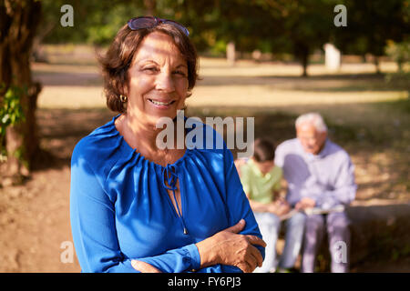 Grandparents educating grandson: Senior woman and old man spending time with their grandchild in park. The old people - Stock Photo